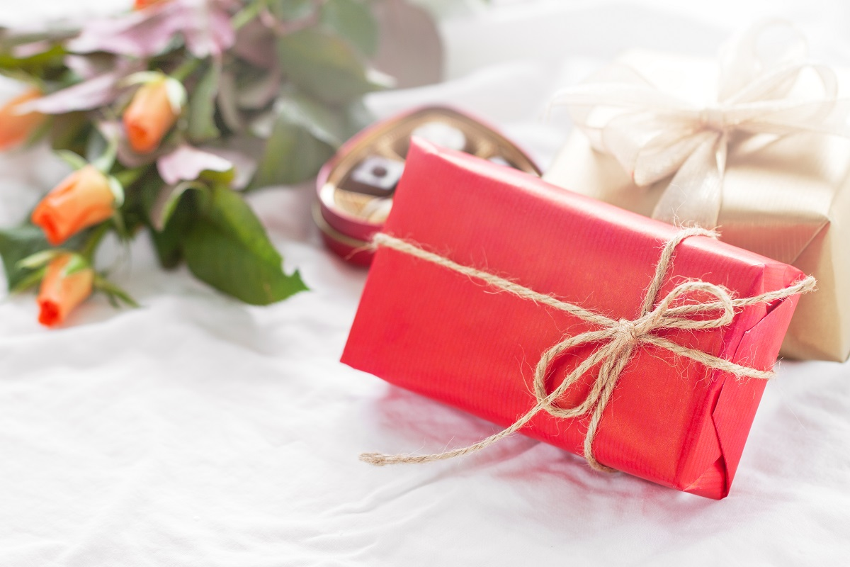 Beautiful colourful pretty gift or present in a natural paper wi