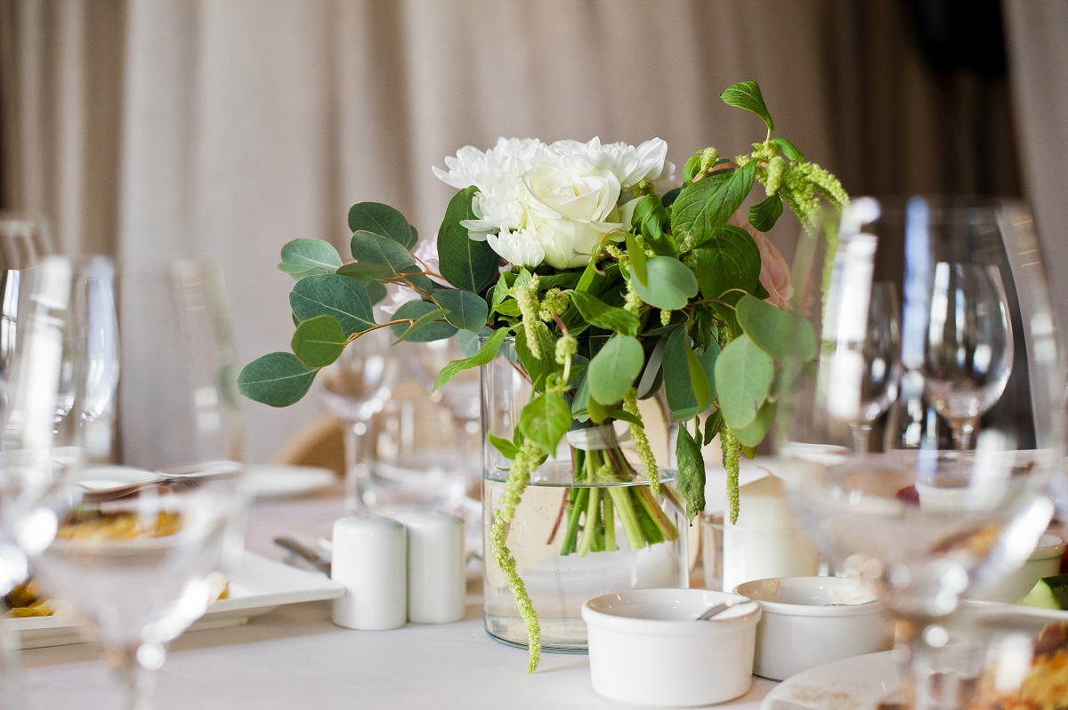 Wedding dinner in the restaurant, tables decorated with vases of