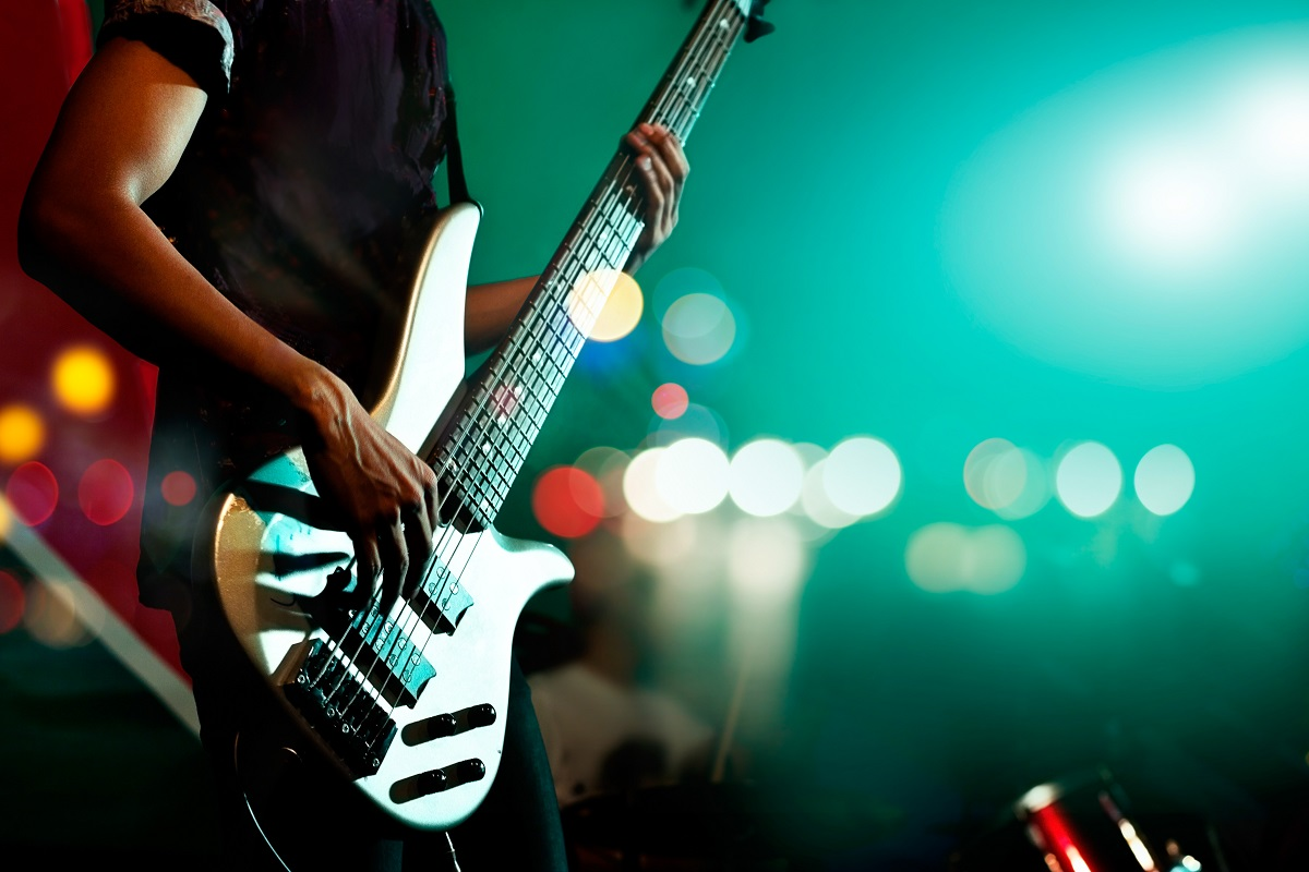 Guitarist bass on stage for background, colorful, soft focus and