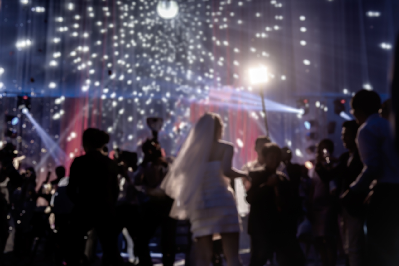 A wedding reception with a large number of guests