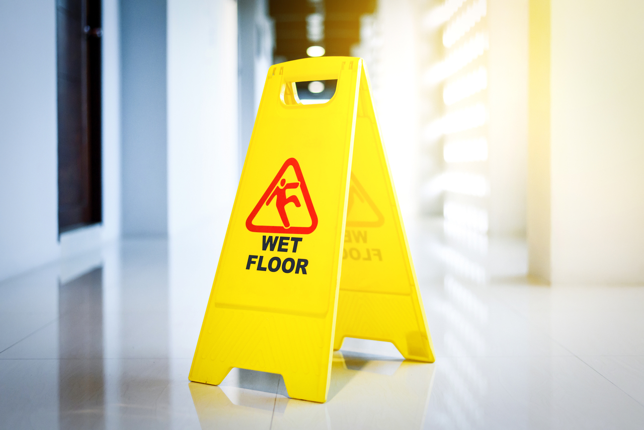 A Wet Floor sign in a hotel