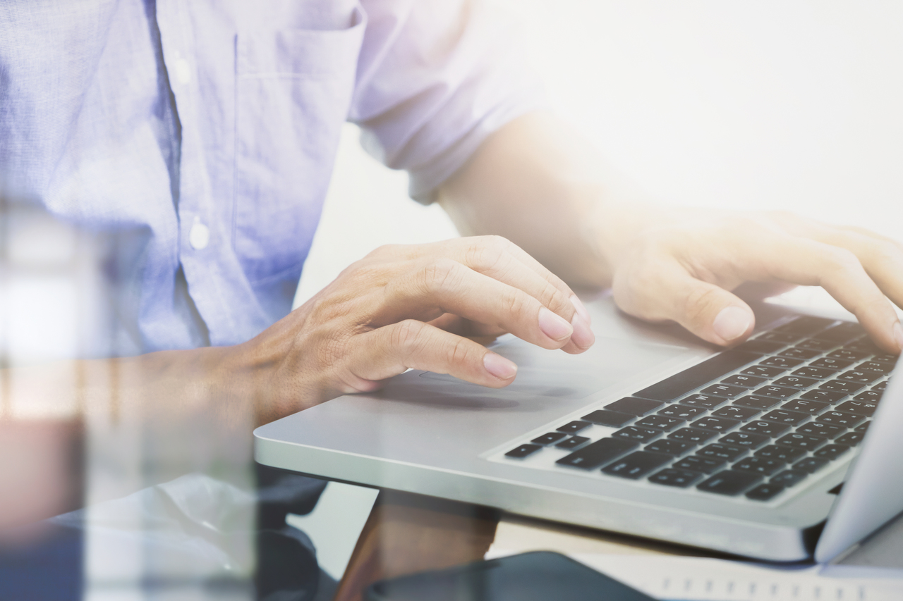 A man doing digital marketing on a laptop