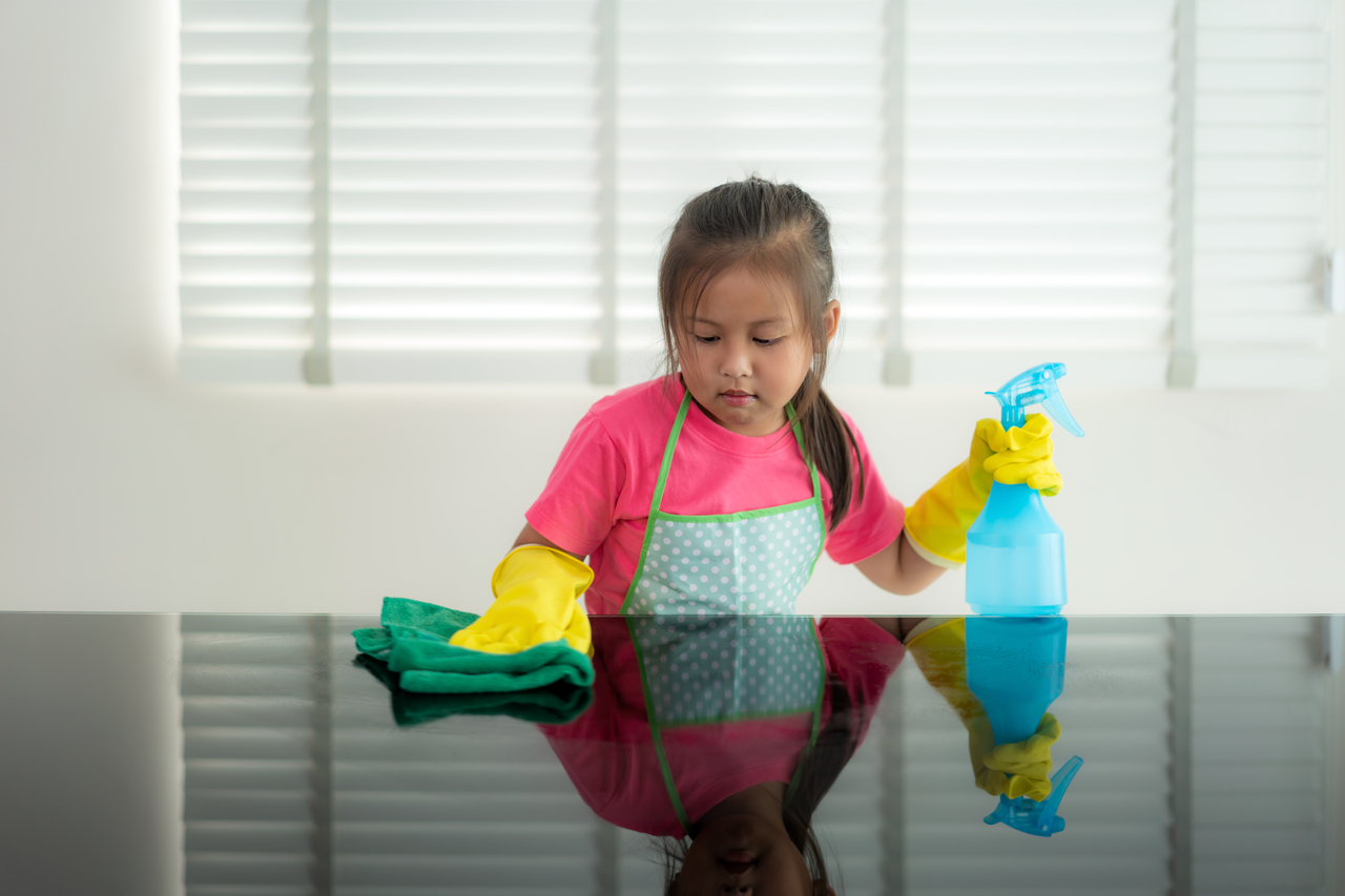 A child doing chores for mother's day