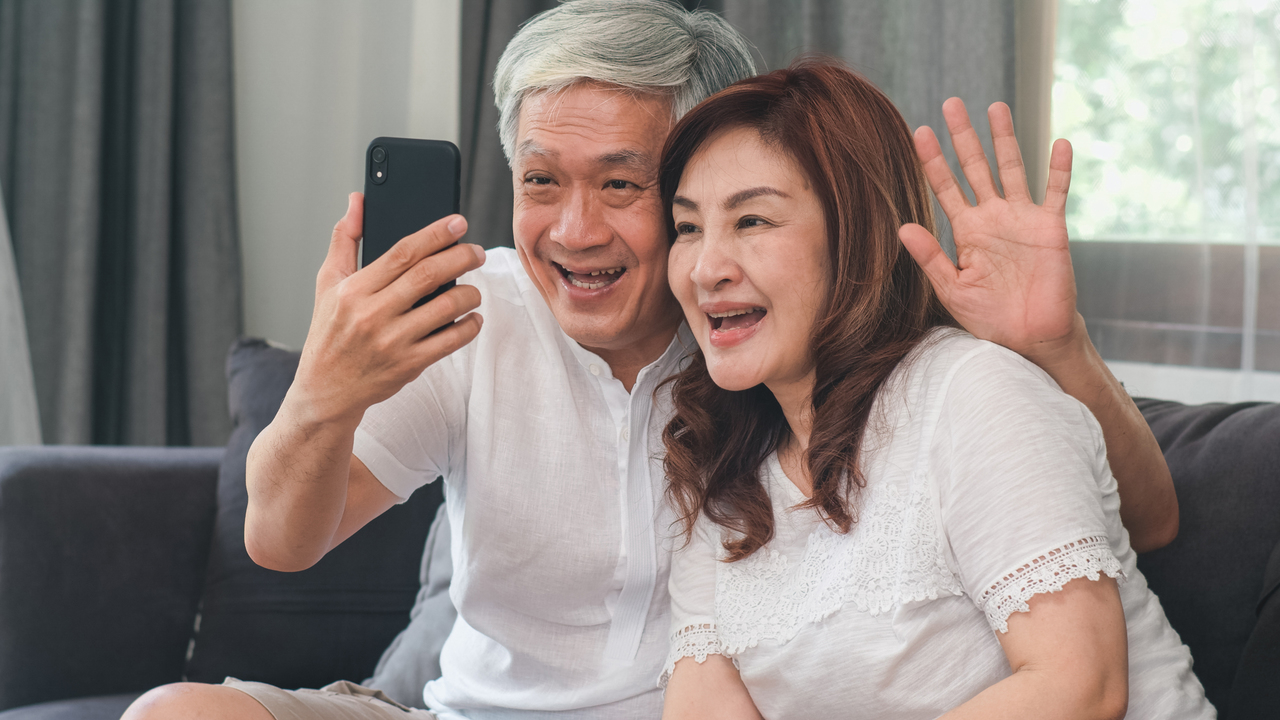 An elderly couple at a virtual party